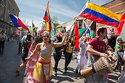 Participants dance and waive the flags of their nations during the annual International Street Fair 2015.