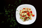 Orecchiette pasta with fresh cherry tomatoes and parsley.