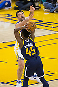 Golden State Warriors center Zaza Pachulia (27) defends Utah Jazz guard Donovan Mitchell (45) at Oracle Arena in Oakland, Calif., on December 27, 2017. (Stan Olszewski/Special to S.F. Examiner)