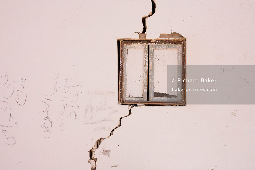 The cracked walls of a police checkpoint outbuilding near Bagdad, Kharga Oasis, Western Desert, Egypt. The desert lies in the New Valley Governorate, 350 km (220 mi.) and measures approximately 80 km (50 mi) from east to west and 25 km (16 mi) from north to south and is patrolled by armed police convoys.