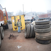 A Tyre exchange and repair kiosk near parking in Punjab.