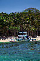 Boat sitting on a tropical beach on the Philipppine island of Boracay.