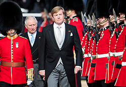 © Licensed to London News Pictures. 23/10/2018. London, UK. King Willem-Alexander is joined by Prince Charles, as he inspects the guard, during a ceremony on Horse Guards Parade in London for the arrival of King Willem-Alexander and Queen Maxima of the Netherlands as part of a state visit to the UK. Photo credit: Ben Cawthra/LNP