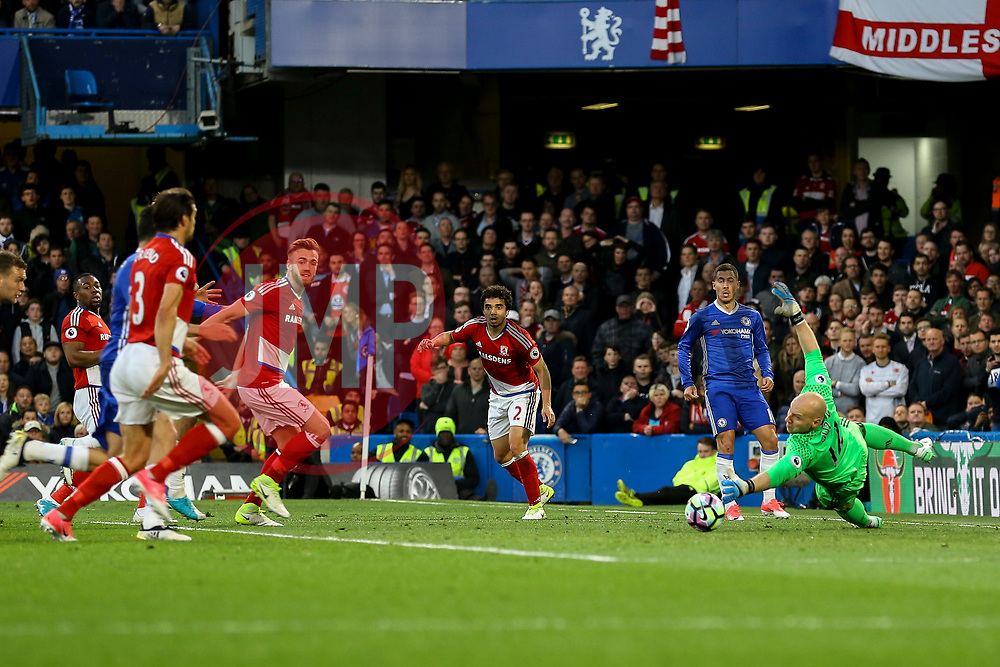 Eden Hazard of Chelsea slides the ball past Brad Guzan of Middlesbrough - Mandatory by-line: Jason Brown/JMP - 08/05/17 - FOOTBALL - Stamford Bridge - London, England - Chelsea v Middlesbrough - Premier League