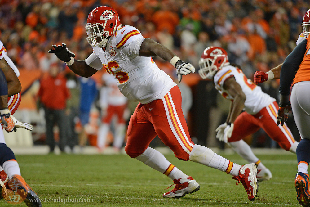 November 17, 2013; Denver, CO, USA; Kansas City Chiefs tackle Branden Albert (76) blocks during the second quarter against the Denver Broncos at Sports Authority Field at Mile High. The Broncos defeated the Chiefs 27-17.