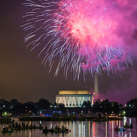 Boaters floating on the Potomac River watch as fireworks burst over the Lincoln Memorial during Fourth of July celebrations in Washington, Saturday July 4, 2015. CREDIT: J. David Ake