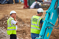 © Licensed to London News Pictures. 13/08/2018. Buntingford, UK.  Representatives from McCarthy and Stone and Fenton examine the scene in Ermine Street after a man demolished at least six nearly finished houses using a digger on Saturday. Police have charged builder Daniel Neagu, 30, with criminal damage. Photo credit: Cliff Hide/LNP