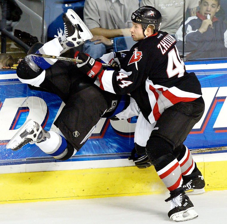 Buffalo Sabres' Alexei Zhitnik of Ukraine checks Tampa Bay Lightning's Jimmie Olvestad, upending him into the boards during the first period on Sunday, March 17, 2002, in Tampa, Fla. (AP Photo/Scott Audette)