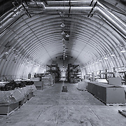 Logistics Arch, in the ice at the South Pole Station. These spaces are at a constant temperature of the surrounding ice, -49 C (-57 F). The arch was originally built at the surface level, but snow accumulation, primarily from drifting snow, has buried the arch, causing concerns for the structural integrity of these storage and work spaces.