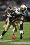 ST. LOUIS - SEPTEMBER 23:  Cornerback Ron Bartell #32 of the St. Louis Rams breaks up a pass play intended for wide receiver Donte' Stallworth #83 of the New Orleans Saints at the Edward Jones Dome on September 23, 2005 in St. Louis, Missouri. The Rams defeated the Saints 28-17. ©Paul Anthony Spinelli *** Local Caption *** Ron Bartell;Donte' Stallworth