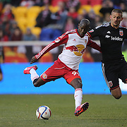 Bradley Wright-Phillips , New York Red Bulls, shoots past Perry Kitchen, D.C. United, during the New York Red Bulls Vs D.C. United, Major League Soccer regular season opening match at Red Bull Arena, Harrison, New Jersey. USA. 22nd March 2015. Photo Tim Clayton