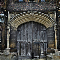 Ancient door on Cambridge University college, england