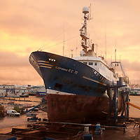 A ship pulled to shore  for maitenance work in Reykjavik, Iceland.