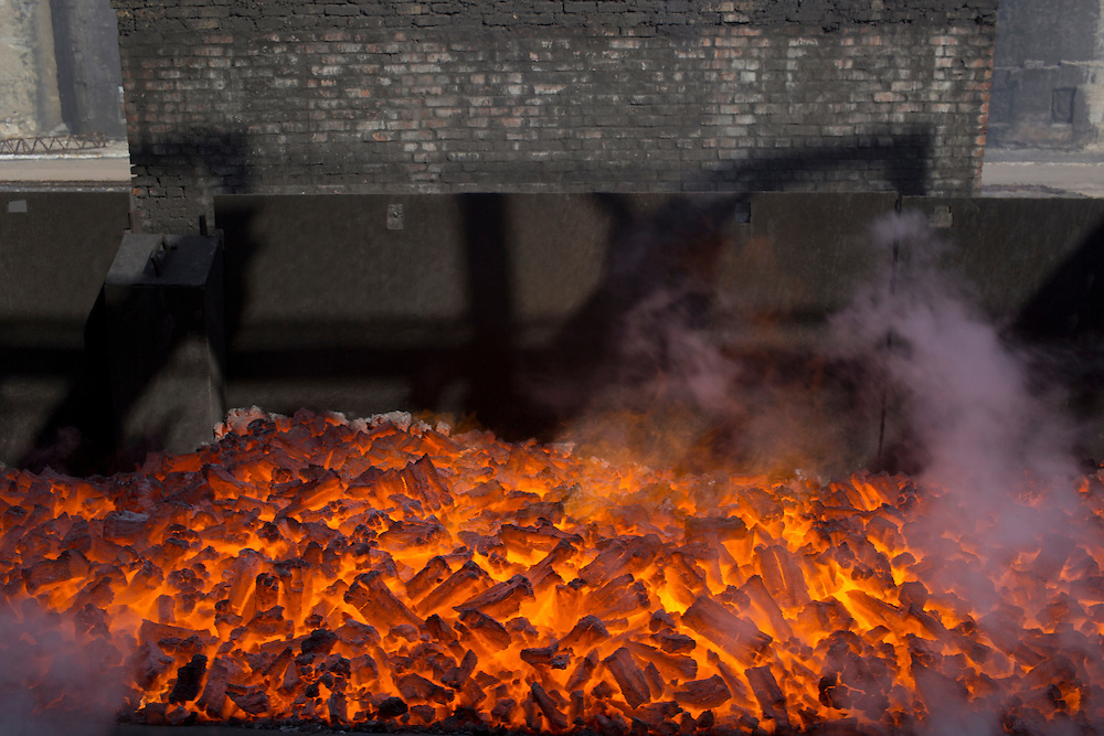 Hot cokes are seen during the production process at the Metinvest Coke Plant on March 18, 2015 in Avdiivka, Ukraine. Shells have hit the property of the plant over 150 times, including multiple hits on the plant itself.