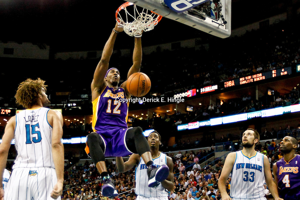 Dec 5, 2012; New Orleans, LA, USA; Los Angeles Lakers center Dwight Howard (12) dunks over New Orleans Hornets center Robin Lopez (15) and small forward Al-Farouq Aminu (0) during the second quarter of a game at the New Orleans Arena.  Mandatory Credit: Derick E. Hingle-USA TODAY Sports