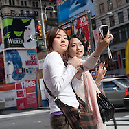New York Times square area,  portrait of pedestrians   in the streets