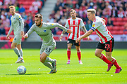 Ben Close (#33) of Portsmouth FC breaks clear of Grant Leadbitter (#23) of Sunderland AFC during the EFL Sky Bet League 1 match between Sunderland and Portsmouth at the Stadium Of Light, Sunderland, England on 17 August 2019.