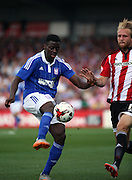 Konstantin Kerschbaumer challanging Yoann Barbet during the Sky Bet Championship match between Brentford and Ipswich Town at Griffin Park, London, England on 8 August 2015. Photo by Matthew Redman.