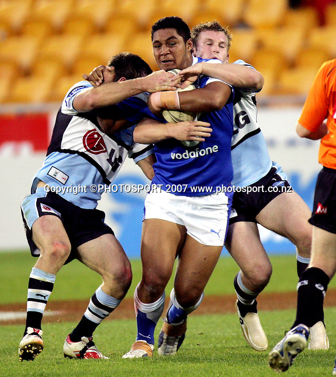 Auckland Lions' Mika Constantine is tackled during the Premier Rugby League match between Auckland Lions and Sharks at Mt Smart Stadium, Auckland, New Zealand on Saturday 5 May 2007. The Sharks won the match 26 - 24. Photo: Hagen Hopkins/PHOTOSPORT<br /><br /><br /><br />050507