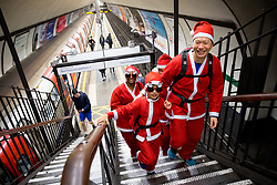 "© Licensed to London News Pictures. 03/12/2017. London, UK. Runners participate in the ""Santa Dash"", a charity running race organised by Great Ormond Street Hospital. Participants dressed as Santa take part in a 5k or 10k race around Clapham Common. Photo credit : Tom Nicholson/LNP"