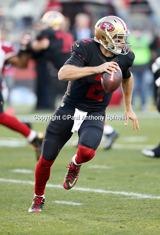 San Francisco 49ers quarterback Blaine Gabbert (2) rolls to his right and throws a fourth quarter pass for a gain of 16 yards and a first down during the 2015 week 12 regular season NFL football game against the Arizona Cardinals on Sunday, Nov. 29, 2015 in Santa Clara, Calif. The Cardinals won the game 19-13. (©Paul Anthony Spinelli)