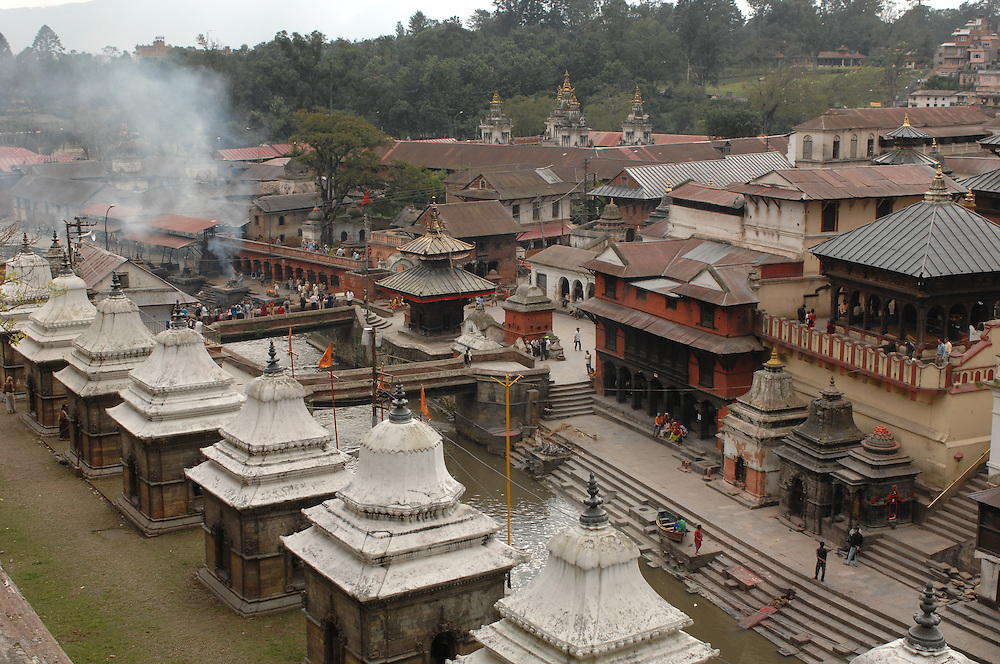 A view of Pashupatinath Temple, with crematory smoke in the background, in Kathmandu, Nepal.
