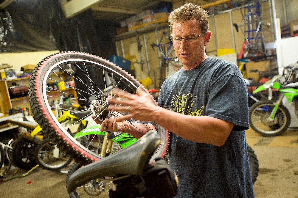 060811       Brian Leddy.Todd Costley works on a bike at his business on Tuesday. Costley's shop, which goes by the name Sports World,is one of two new bike shops to open in Gallup recently.