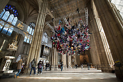 "@Licensed to London News Pictures 22/02/2018. Canterbury, UK. Artist Arabella Dorman installation called ""Suspended"" opens to the public tomorrow 23rd February 2018 in the nave of Canterbury Cathedral in Kent. This evocative artwork highlights the plight of refugees around the world and is made up of hundreds of items of refugee clothing found mainly on the beaches of the Greek Island of Lesbos. Photo credit: Manu Palomeque/LNP"