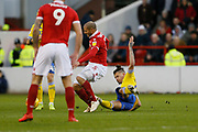 Leeds United midfielder Kalvin Phillips (23) fouls Nottingham Forest midfielder Adlene Guedioura (5) and receives a red card during the EFL Sky Bet Championship match between Nottingham Forest and Leeds United at the City Ground, Nottingham, England on 1 January 2019.
