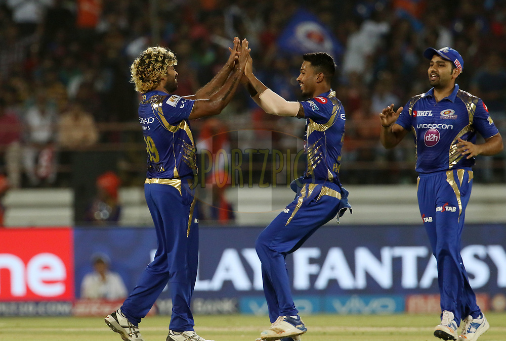 Lasith Malinga of the Mumbai Indians celebrates the wicket of Aaron Finch of the Gujarat Lions during match 35 of the Vivo 2017 Indian Premier League between the Gujarat Lions and the Mumbai Indians  held at the Saurashtra Cricket Association Stadium in Rajkot, India on the 29th April 2017<br /> <br /> Photo by Vipin Pawar - Sportzpics - IPL