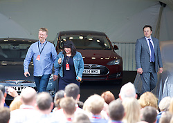 LONDON, ENGLAND - Saturday, June 7, 2014: The third UK owner of a Tesla Model S, 50 Shades of Grey author EL James (Erika Mitchell) with husband Niall Leonard, at the UK launch of Tesla Motors' Model S electric car at the Crystal. (Pic by David Rawcliffe/Propaganda)