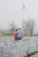 From left, Diana Schmidt and her husband Bob Schmidt of Langhorne visit the grave of Diana;s father during Wreaths Across America Saturday, December 14, 2019 at Washington Crossing National Cemetery in Newtown, Pennsylvania. Thousands of wreaths are laid each year for Wreaths Across America by volunteers who gather and then place the wreaths at graves of veterans. (Photo by William Thomas Cain / CAIN IMAGES)