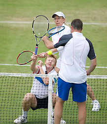 LIVERPOOL, ENGLAND - Saturday, June 18, 2011: Martina Navratilova (USA) and Andrey Golubev (KZE) take on Barry Cowan (GBR) in action during day three of the Liverpool International Tennis Tournament at Calderstones Park. (Pic by David Rawcliffe/Propaganda)