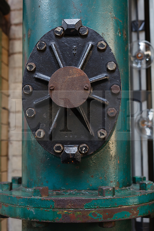 © Licensed to London News Pictures. 01/12/2013. London, UK. Image date: 28 August 2012. Original hydraulic machinery and equipment inside the Wapping Project restaurant (formerly the Wapping Hydraulic Power Station). The Wapping Project restaurant and art space will close at the end of 2013. Photo credit : Vickie Flores/LNP
