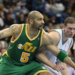 Feb 17, 2010; New Orleans, LA, USA; Utah Jazz forward Carlos Boozer (5) fights with New Orleans Hornets forward Darius Songaila (9) for position under the basket during the second quarter at the New Orleans Arena. Mandatory Credit: Derick E. Hingle-US PRESSWIRE