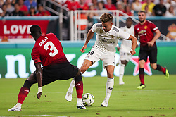 July 31, 2018 - Miami Gardens, Florida, USA - Real Madrid C.F. midfielder Marcos Llorente (18) disputes the ball with Manchester United F.C. defender Eric Bailly (3) during an International Champions Cup match between Real Madrid C.F. and Manchester United F.C. at the Hard Rock Stadium in Miami Gardens, Florida. Manchester United F.C. won the game 2-1. (Credit Image: © Mario Houben via ZUMA Wire)