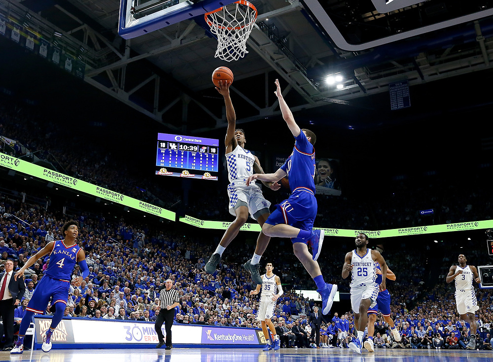 Kentucky Wildcats guard Malik Monk goes up for a layup defended by Kansas Jayhawks guard Sviatoslav Mykhailiuk on Saturday January 28, 2017 at Rupp Arena in Lexington, Ky. Photo by Michael Reaves | Staff