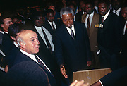 African National congress President Nelson Mandela extends his hand to then South African President F.W. de Klerk at the World Trade Centre near Johannesburg 1993. The two leaders met after negotiators finished work on an interim constitution and bill of rights for a post-apartheid South Africa.<br /> <br /> Photograph &copy; nic bothma