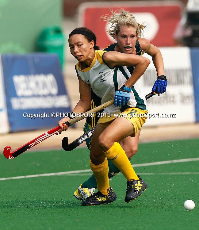 South Africa's Lenise Marais defends against Australia's Casey Eastham. Hockey, Australia v South Africa, Day 5, XIX Commonwealth Games, New Delhi, India. Friday 8th October 2010. Photo: Simon Watts / photosport.co.nz