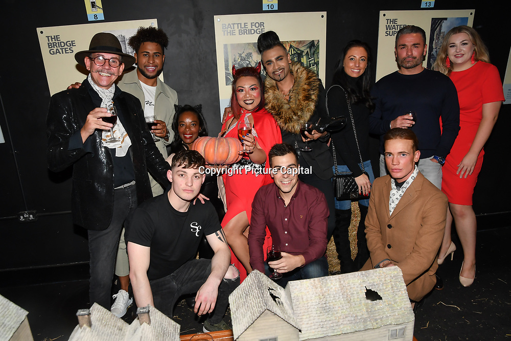 Liam Craigie is a model front (L) attend Press night an halloween experience at  London Tombs at The London Bridge Experience, UK. 18 October 2018.