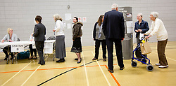 © Licensed to Alison Baskerville. 02/05/2013. Warwickshire, UK.  Pepe the dog watches his owners cast their vote in the local elections as members of the local community arrived this morning at the Castle Farm Leisure Centre in the historic town of Kenilworth.  The results are set to be scrutinised by the major parties as over 34 local authorities take part in todays elections.  Photo credit: Alison Baskerville/LNP..**PLEASE NOTE:  Consent has been gained from everyone featured in this set of images.**