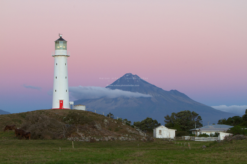 Cape Egmont marks the westernmost point of the Taranaki region of New Zealand. Standing guard over it is the Cape Egmont Lighthouse that was originally built on Mana Island near Porirua near Wellington but relocated to Cape Egmont in 1877. Visible behind the lighthouse is Mount Taranaki (aka Mount Egmont). Mount Taranaki's solitary volcanic peak dominates the geography of the entire Taranaki region.