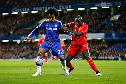Willian of Chelsea is challenged by Mamadou Sakho of Liverpool - Photo mandatory by-line: Rogan Thomson/JMP - 07966 386802 - 27/01/2015 - SPORT - FOOTBALL - London, England - Stamford Bridge - Chelsea v Liverpool - Capital One Cup Semi-Final Second Leg.