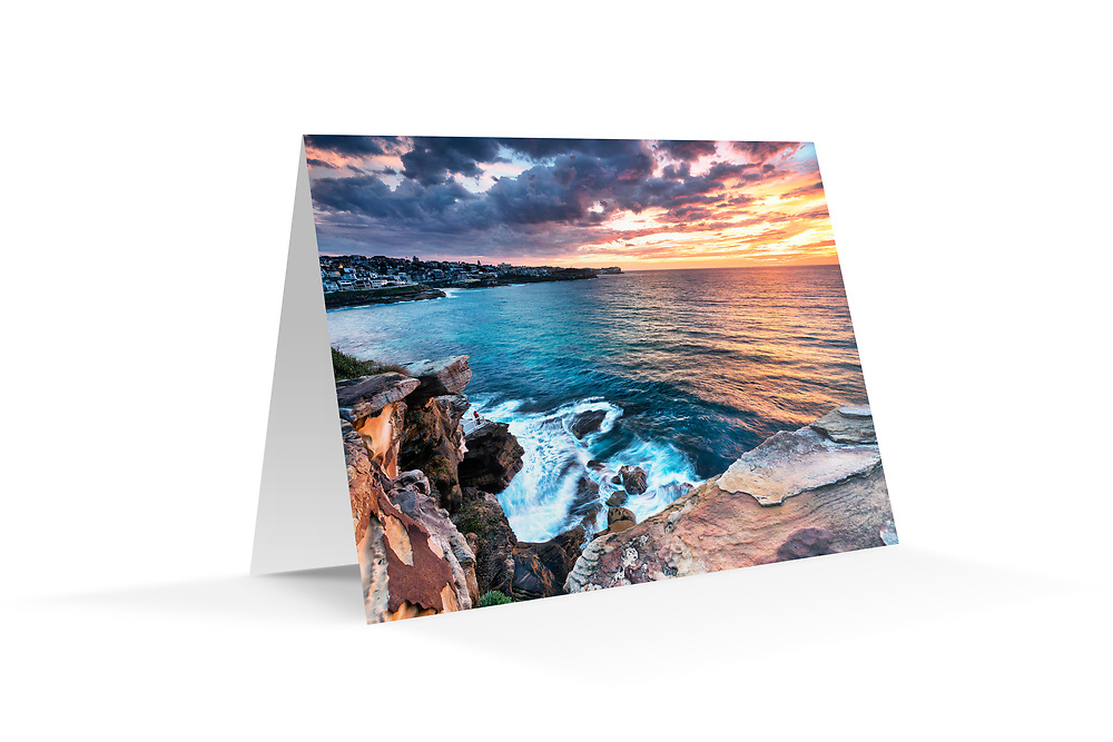 "Photo Art Greeting Card - Sydney Coastal Collection (Bronte Sunrise). Printed in Sydney on quality matte card stock, 174 x 123mm, blank inside, envelope included, packaged in sealed poly bag. Click ""Add to Cart"" to choose your own mix of 5, 10, or 20 cards from this collection."