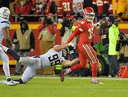 Dec 13, 2018; Kansas City, MO, USA; Kansas City Chiefs quarterback Patrick Mahomes (15) scrambles as Los Angeles Chargers defensive end Joey Bosa (99) pressures during the second half at Arrowhead Stadium. The Chargers won 29-28. Mandatory Credit: Denny Medley-USA TODAY Sports