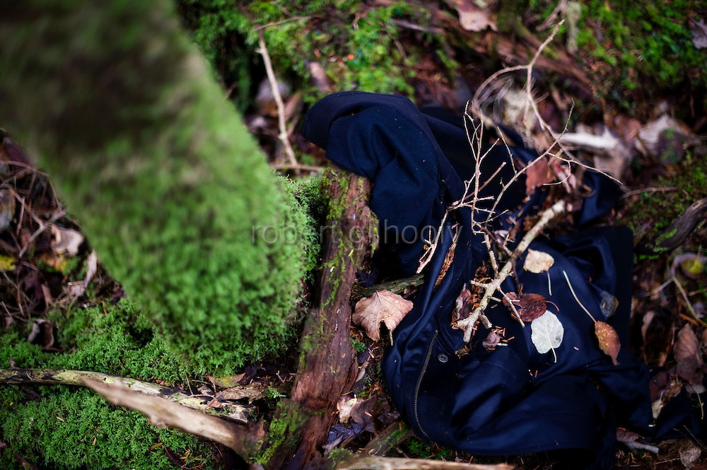 A jacket lies at the foot of a tree in Aokigahara Jukai, better known as the Mt. Fuji suicide forest, in Yamanashi Prefecture west of Tokyo, Japan. .