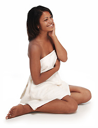 beautiful young woman with hand on face with white towel on whtie background.