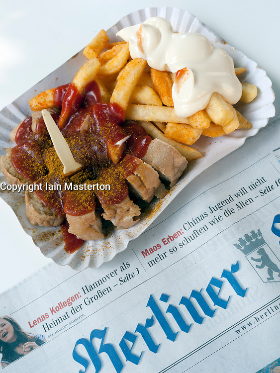 Detail of traditional Berlin curry-wurst snack at famous Konnopke`s currywurst stall in Prenzlauer Berg in Berlin Germany