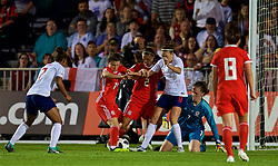 NEWPORT, WALES - Friday, August 31, 2018: Wales' Hayley Ladd, Loren Dykes and goalkeeper Laura O'Sullivan block England's Jodie Taylor during the FIFA Women's World Cup 2019 Qualifying Round Group 1 match between Wales and England at Rodney Parade. (Pic by David Rawcliffe/Propaganda)