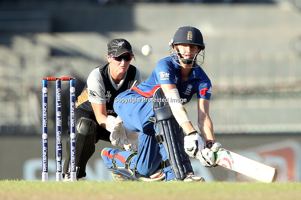 Lydia Greenway of England sweeps the ball during the ICC Women's World Twenty20 Semi final match between England and New Zealand held at the Premadasa Stadium in Colombo, Sri Lanka on the 4th October  2012<br /> <br /> Photo by Ron Gaunt/SPORTZPICS/PHOTOSPORT
